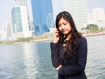 Businesswoman Outside Office On Mobile Phone Royalty Free Stock Photography