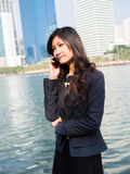 Businesswoman Outside Office On Mobile Phone Royalty Free Stock Photos