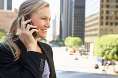 Businesswoman Outside Office On Mobile Phone Royalty Free Stock Image