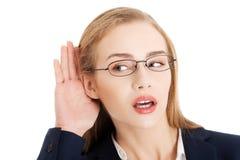 Businesswoman overhears Stock Photos