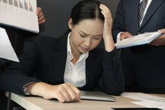 Businesswoman overwhelmed with hard work. overworked woman suffering stress. exhausted secretary burnout. Desperate businesswoman overwhelmed with hard work Stock Image