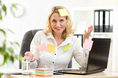 Businesswoman overwhelmed with sticky reminder Royalty Free Stock Photo