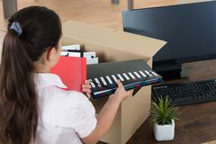 Businesswoman Packing Belongings In Cardboard Box Stock Image