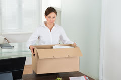 Businesswoman Packing Her Belongings Stock Image