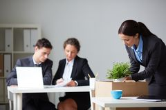 Businesswoman packing things Royalty Free Stock Photo