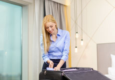 Businesswoman packing things in suitcase Stock Photos