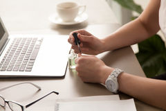 Businesswoman painting nails at office royalty free stock photos