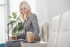 Businesswoman with paper cup of coffee Royalty Free Stock Image
