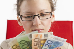Businesswoman with paper money fanned Stock Image