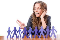 Businesswoman with paper people Royalty Free Stock Image