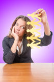 Businesswoman with paper people on white Stock Photos