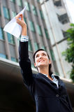 Businesswoman with Paper Plane Stock Photography