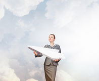 Businesswoman with paper plane . Mixed media royalty free stock images