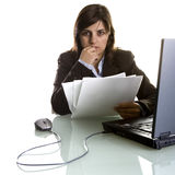 Businesswoman with paper reports and laptop Royalty Free Stock Photography