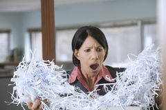 Businesswoman with paper shreds Royalty Free Stock Images