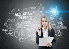 Businesswoman with papers and business plan sketch Royalty Free Stock Photos