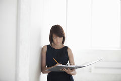 Businesswoman With Paperwork In Empty Warehouse Royalty Free Stock Photo