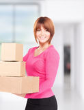 Businesswoman with parcels Royalty Free Stock Photography