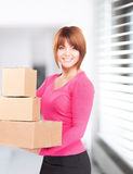 Businesswoman with parcels Stock Photo