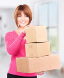 Businesswoman with parcels. Picture of businesswoman with parcels in office stock photo