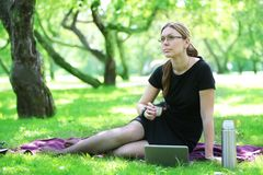 Businesswoman in the park Royalty Free Stock Images