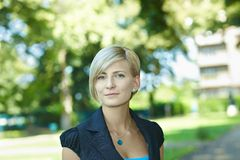 Businesswoman in park Royalty Free Stock Image
