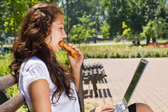 Businesswoman in park on break eating Stock Photography