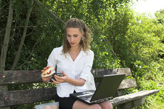 Businesswoman in the park; healthy lunch Stock Photos