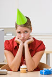 Businesswoman in party hat with birthday cupcake Royalty Free Stock Photos