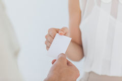 Businesswoman passing her business card Stock Image