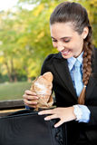 Businesswoman with pastry Royalty Free Stock Photos
