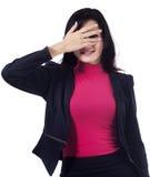 Businesswoman peeking from fingers Stock Photo