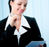 Businesswoman with pen stock photos