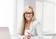 Businesswoman with pen Royalty Free Stock Photos
