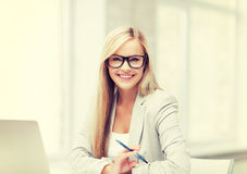 Businesswoman with pen Stock Images
