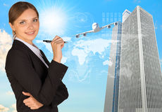 Businesswoman with pen looking at camera Stock Photography