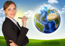 Businesswoman with pen looking at camera Stock Photos