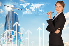 Businesswoman with pen looking at camera Stock Image