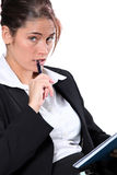 Businesswoman  with pen and notepad Stock Photos