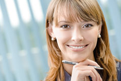 Businesswoman with pen at office. Portrait of businesswoman with pen at office Royalty Free Stock Images