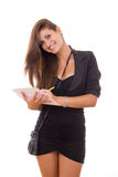 Businesswoman with pen and paper. Young smiling businesswoman with pen and paper standing Stock Images