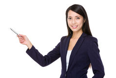Businesswoman with pen point aside Stock Images