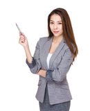 Businesswoman with pen point up Stock Image