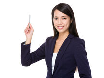 Businesswoman with pen point upwards Royalty Free Stock Photo