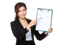 Businesswoman pen pointing to the blank page of clipboard Stock Images