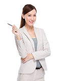 Businesswoman with pen up Stock Images