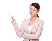 Businesswoman with pen up Stock Photography