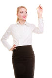 Businesswoman with pen writing on screen Royalty Free Stock Photography