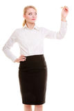 Businesswoman with pen writing on whiteboard royalty free stock photography