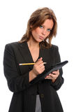 Businesswoman With Pencil and Notepad Royalty Free Stock Photography